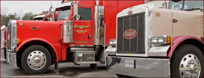 Two transport trucks