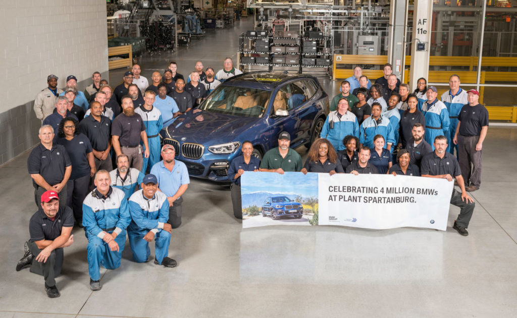 photo of BMW workers celebrating 4 million vehicles